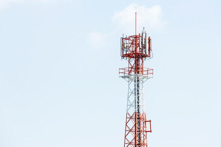 repeater: Red and white color antenna repeater tower on blue sky