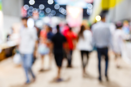 motion blur: Abstract blurred people walking in shopping centre Stock Photo