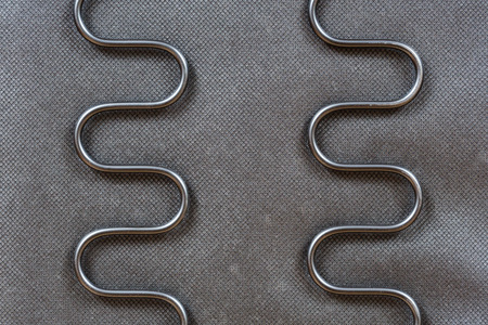 sinuous: Close up black color coil sinuous wire spring system for seat or bed support
