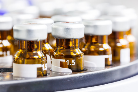 Close up amber color vials with inserts and crimp septum caps Standard-Bild