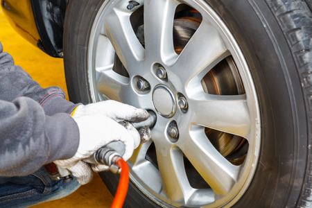 Car brake repairing in garage, automotive service station photo