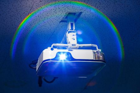 audiovisual: Projector hang on ceiling in meeting room with real halo effect