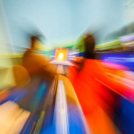 zooming: Abstract real lens zooming effect on notebook monitor in seminar room, creative idea concept Stock Photo