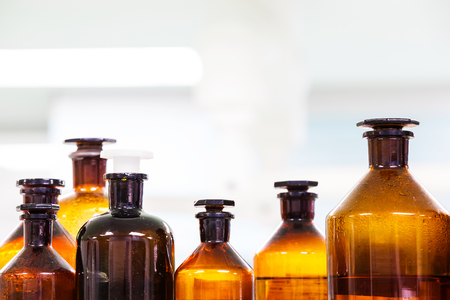 reagent: Close up amber color bottles in laboratory Stock Photo