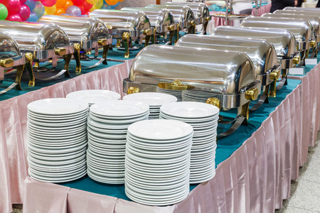 Close up stainless steel countertop food warmer and dish on table, catering concept photo