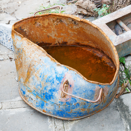 steel bucket: Close up rusty and distorted steel bucket in construction site