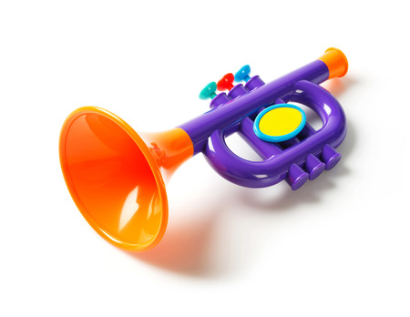 Close up plastic toy trumpet for children isolated on white