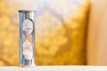 hourglass: Close up hourglass or sand glass in living room, time value  concept Stock Photo
