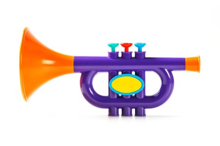 Close up plastic toy trumpet for children isolated on white stock close up plastic toy trumpet for children isolated on white photo sciox Choice Image
