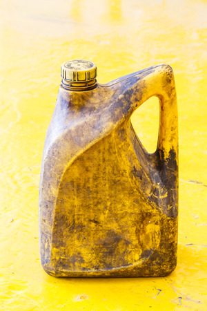 dirty car: Close up old and dirty car engine oil gallon, plastic container, automotive maintenance service