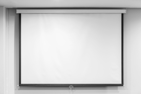 Blank projector screen in seminar room, education concept