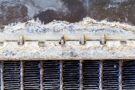 dirty car: Close up dirty stain on leaky car radiator, automotive maintenance service Stock Photo