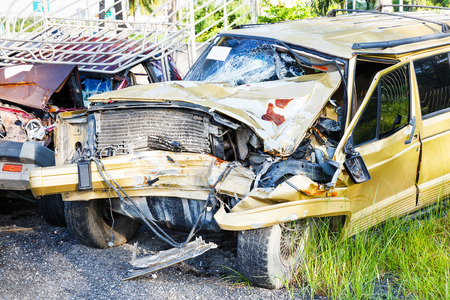 junk car: Old and rusty damaged car wreck in junk yard, drive safety concept Stock Photo