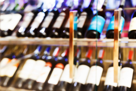 Abstract blurred wine cellar cabinet in luxury restaurant Standard-Bild