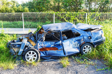 tumble down: Old and rusty damaged car wreck in junk yard, drive safety concept Stock Photo