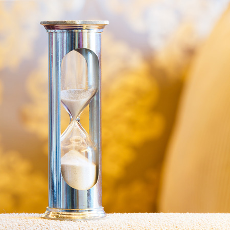 ancient pass: Close up hourglass or sand glass in living room, time value  concept Stock Photo