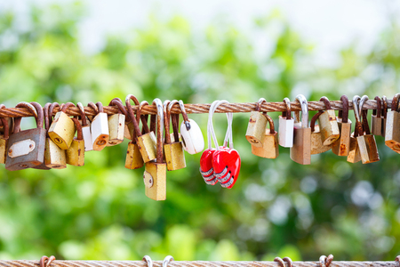 padlocks: Rusty padlocks hang on sling, love forever concept