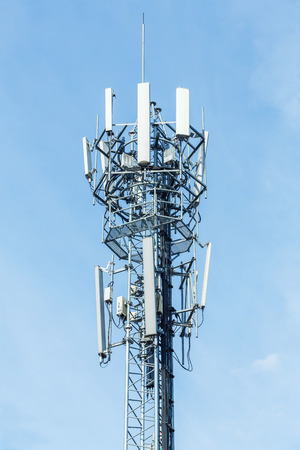 angle bar: White color antenna repeater tower on blue sky, telecommunication concept Stock Photo
