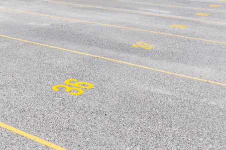 numeric: Concrete road texture with yellow color lines and numeric, outdoor parking lot, empty street