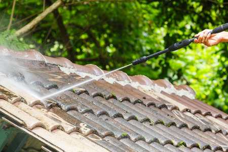 pressure washing: Roof cleaning with high pressure water cleaner