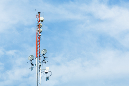 angle bar: White and red color antenna repeater tower on blue sky, telecommunication concept Stock Photo