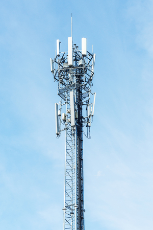 repeater: White color antenna repeater tower on blue sky, telecommunication concept Stock Photo