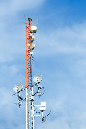repeater: White and red color antenna repeater tower on blue sky, telecommunication concept Stock Photo