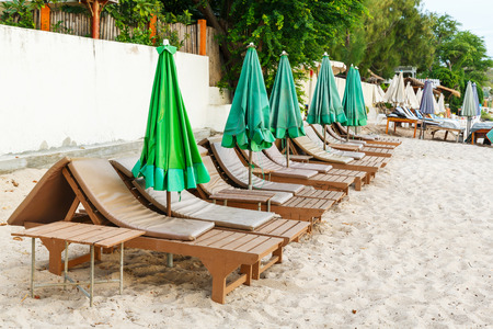 not ready: Beach chairs and umbrella in early morning, not ready to use Stock Photo
