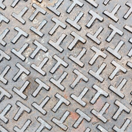 sewer: Close up old and dirty steel sewer lid texture Stock Photo
