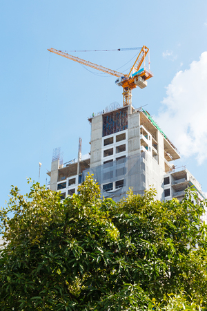 conept: Yellow color crane with new building, construction conept