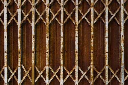 collapsible: Rusty steel collapsible door texture, old fashion style shutter gate Stock Photo