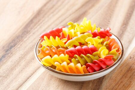 Close up gluten free corn and vegetable pasta spirals macaroni, food for wheat allergy person