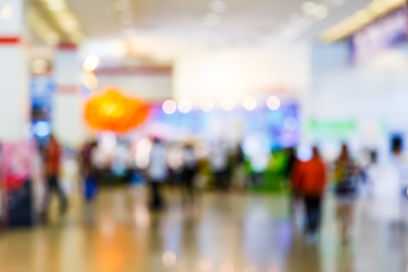 Abstract blur people walking in exhibition hall, trade show concept