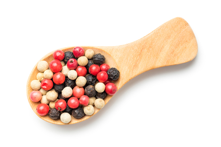 medley: Close up medley trio colorful peppercorn in wooden spoon isolated on white background Stock Photo