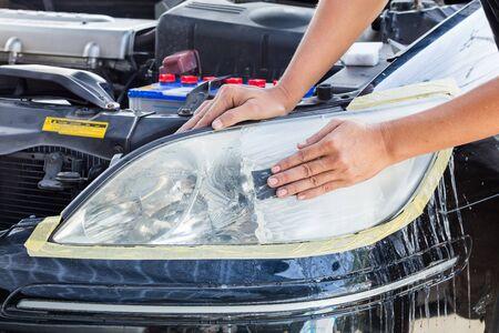 Close up car lamp or front headlight polishing, renewed headlamp