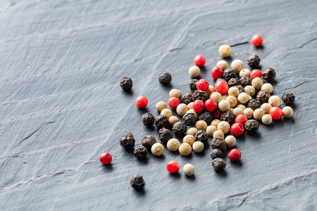 medley: Close up medley trio colorful peppercorn on stone background