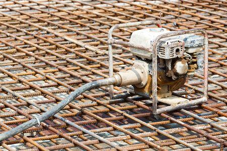 concrete pump: Close up concrete vibrator pump in construction site Stock Photo
