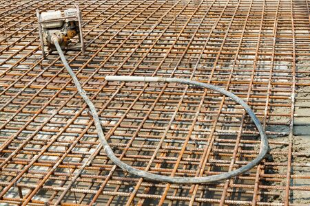 vibrator: Close up concrete vibrator pump in construction site Stock Photo