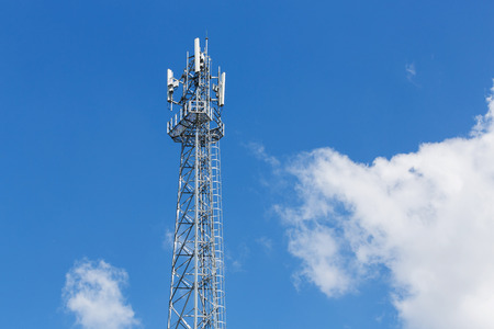 Antenna repeater tower on blue sky, wireless telecommunication concept