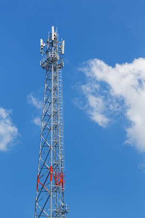 wireless tower: Antenna repeater tower on blue sky, wireless telecommunication concept