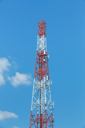 galvanized: Antenna repeater tower on blue sky, wireless telecommunication concept