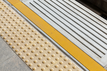 Blind floor tiles on train station platform, modern urban lifestyle concept