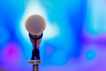 Close up microphone in press conference event or lecture room with blur background Stock Photo