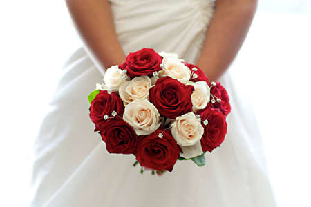 wedding bouquet: Beautiful Bouquet of Red & White Roses held by a bride Stock Photo