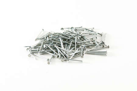 Pile of shiny metal nails against a white background photo