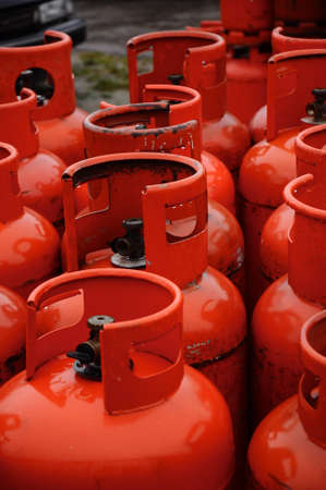 Red gas cannisters lined up in a row Stock Photo - 15933099