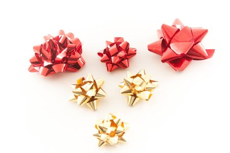 gold and red christmas bows arranged in a heart shape stock photo 17076201 - Red Christmas Bows
