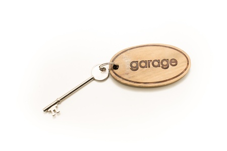 key fob: Large Wooden Garage Key Fob with a large metal key attached Stock Photo