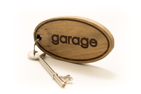 fob: Large Wooden Garage Key Fob with a large metal key attached Stock Photo