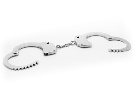 Open Metal Handcuffs isolated on a white background photo
